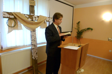 Pastor Varga preaching on a Sunday